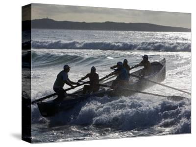 New South Wales, A Surfboat Crew Battles Through Waves at Cronulla Beach in Sydney, Australia