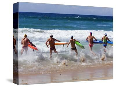 Surf Lifesavers Sprint for Water During a Rescue Board Race at Cronulla Beach, Sydney, Australia