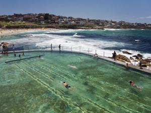 Swimmers Do Laps at Ocean Filled Pools Flanking the Sea at Sydney's Bronte Beach, Australia by Andrew Watson