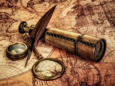 Vintage Magnifying Glass, Compass, Goose Quill Pen And Spyglass Lying On An Old Map by Andrey Armyagov