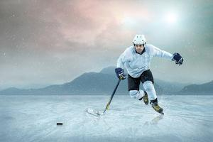 Ice Hockey Player on the Ice, Outdoor. by Andrey Yurlov