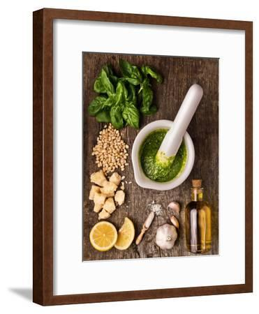 Sauce Pesto and its Ingredients on Rough Wood