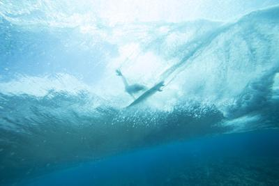 Underwater View of a Surfer on a Surfboard