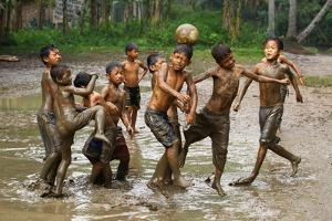 Playing Football by Angela Muliani Hartojo