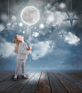 Child Playing With Moon And Stars At Night by Angela_Waye