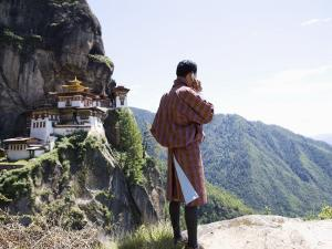 Bhutanese Man with Cell Phone, Taktshang Goemba (Tiger's Nest) Monastery, Paro, Bhutan by Angelo Cavalli