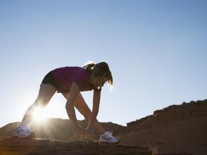 Woman Stretching, Monument Valley Navajo Tribal Park, Arizona Utah Border by Angelo Cavalli