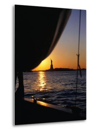 Statue of Liberty at Sunset from Staten Island Ferry, New York City, New York, USA