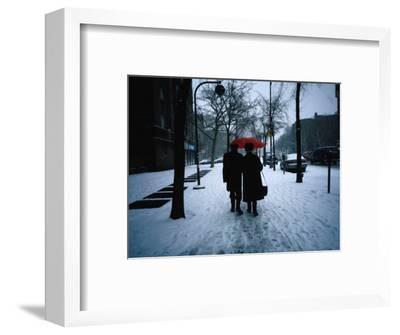 Walking on Snowy Winter Street, New York City, New York, USA
