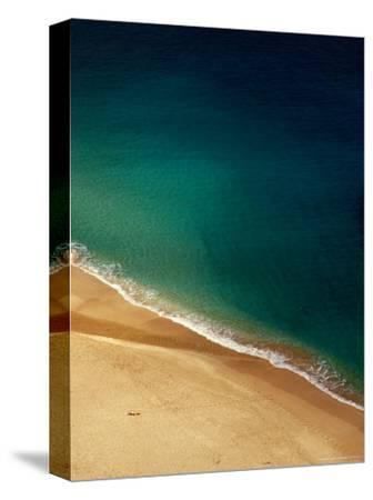 A Lone Sunbather Stretches Out on the Sand, Waimea, Oahu, Hawaii, USA