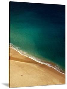 A Lone Sunbather Stretches Out on the Sand, Waimea, Oahu, Hawaii, USA by Ann Cecil