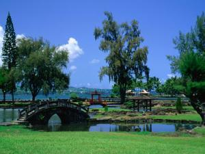 A Wooden Bridge in the Japanese Style in the Liliuokalani Gardens, Hilo, Hawaii, USA by Ann Cecil