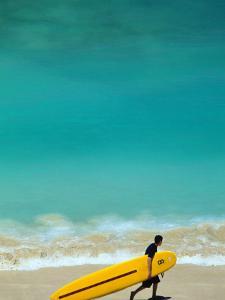 Boy with Yellow Surfboard at Waikiki Beach by Ann Cecil