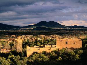 Buildings with Mountain in Distance, Santa Fe, U.S.A. by Ann Cecil