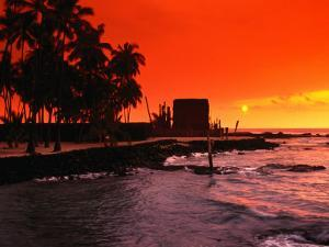 Orange Sunset Over the Sacred Bay, South Kona Coast, Puuhonua O Honaunau National Park, Hawaii, USA by Ann Cecil