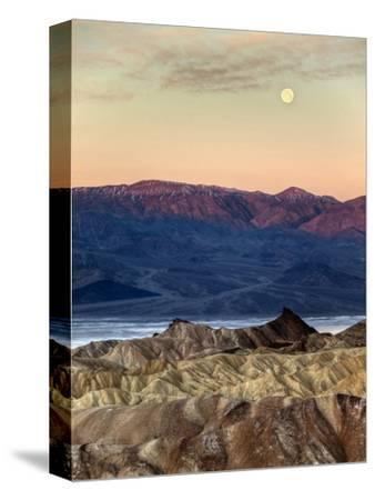 USA, California, Death Valley National Park. Moonset at Sunrise from Zabriskie Point