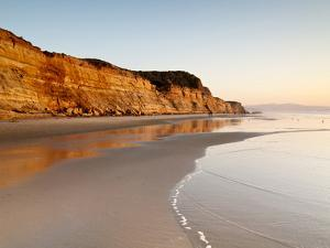 USA, California, La Jolla. Low Tide Cliff Reflections at Torrey Pines State Beach by Ann Collins