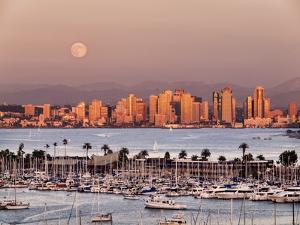 USA, California, San Diego, Full Moon Rises over Boats and City on San Diego Harbor by Ann Collins
