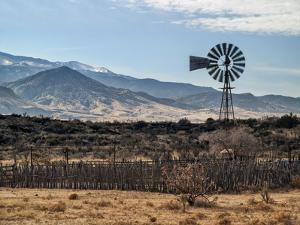 USA, New Mexico, Aermotor windmill and cattle pen by Ann Collins
