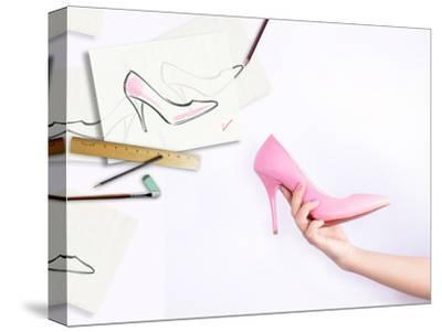 Female Hand Holding Shoe