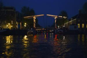 Night View of Amsterdam Canal with Bridge by Anna Miller