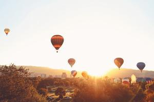 Hot Air Balloons in the Sky during Sunrise Toned with a Retro Vintage Instagram Filter App or Actio by Annette Shaff