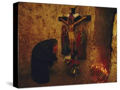A Greek Pilgrim Prays in the Grotto Where Jesus Was Sentenced to Die