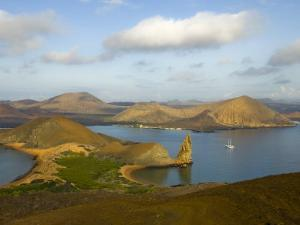 Boat Anchored Offshore of One of the Galapagos Islands by Annie Griffiths Belt