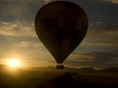 Hot Air Balloon in Flight at Dawn over the Namib Desert