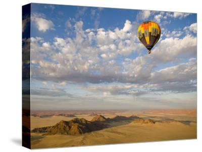 Hot Air Balloon in Flight over the Namib Desert