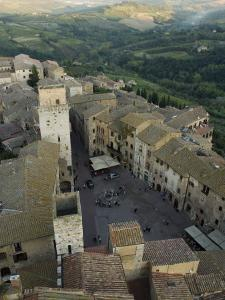 Square in Siena and the Tuscan Countryside Beyond by Annie Griffiths Belt