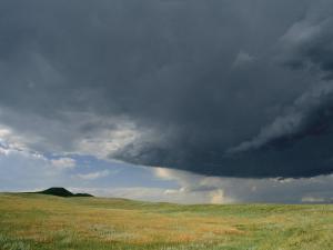 Summer Storm Looms over Prairie by Annie Griffiths Belt