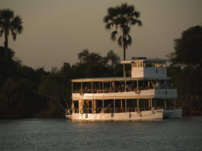 Tour Boat Cruises the Zambezi River, Looking for Wildlife