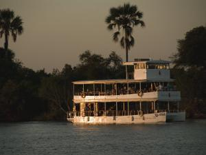 Tour Boat Cruises the Zambezi River, Looking for Wildlife by Annie Griffiths Belt