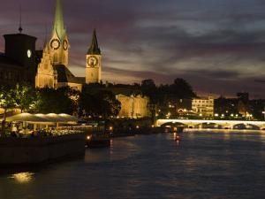 Twilight View across the River Limmat Toward Downtown Zurich by Annie Griffiths Belt