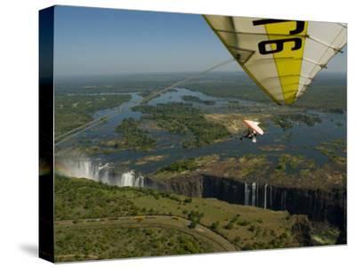 Ultralight Plane Flies Low over Victoria Falls