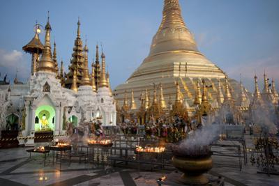 Lit Candles Placed by Devotees at Sunset at the Shwesagon Pagoda, Yangon, Myanmar (Burma)