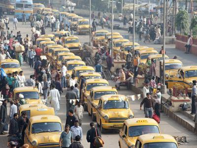 Yellow Kolkata Taxis and Commuters at Howrah Railway Station, Howrah, Kolkata (Calcutta), India