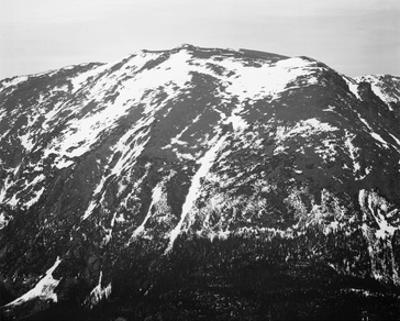Full view of barren mountain side with snow, in Rocky Mountain National Park, Colorado, ca. 1941-19