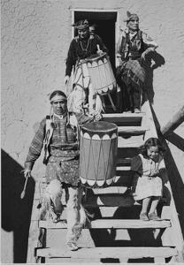 Indians Descending Wooden Stairs Carrying Drums, Dance San Ildefonso Pueblo New Mexico 1942 by Ansel Adams