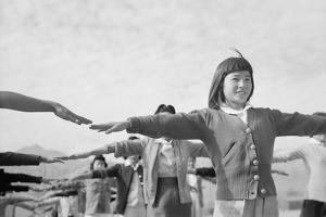 Japanese-American girls exercising at Manzanar, 1943 by Ansel Adams