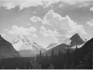 "Looking Across Forest To Mountains And Clouds ""In Glacier National Park"" Montana. 1933-1942 by Ansel Adams"