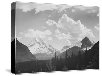 "Looking Across Forest To Mountains And Clouds ""In Glacier National Park"" Montana. 1933-1942"