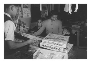 Mrs. Yaeko Nakamura and Family Buying Toys with Fred Moriguchi by Ansel Adams