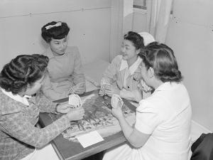 Nurses Aiko Hamaguchi, Chiye Yamanaki, Catherine Yamaguchi, and Kazoko Nagahama playing bridge by Ansel Adams