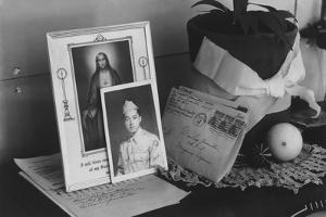 Personal mementoes including autographed photograph at Manzanar Relocation Center, 1943 by Ansel Adams