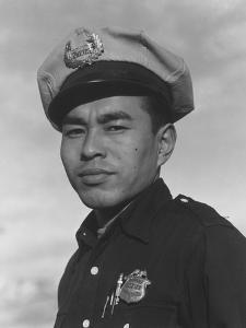 Policeman Sam Bozono at Manzanar, 1943 by Ansel Adams