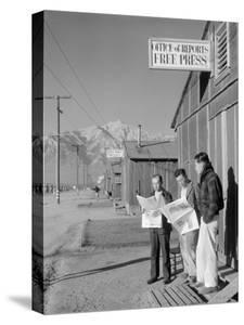 Roy Takeno, Editor, and Group, Manzanar Relocation Center, California by Ansel Adams