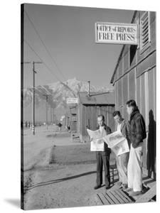 Roy Takeno, Editor, and Group, Manzanar Relocation Center, California by Ansel Adams