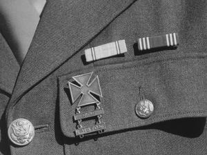 Service ribbons and qualification badge above pocket of military uniform worn by Jimmie Shohara by Ansel Adams
